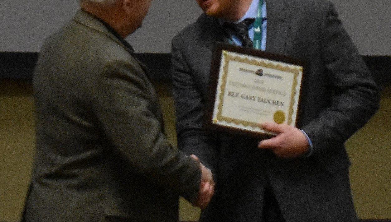 Tauchen Presented Distinguished Legislator Award By Pork Producers
